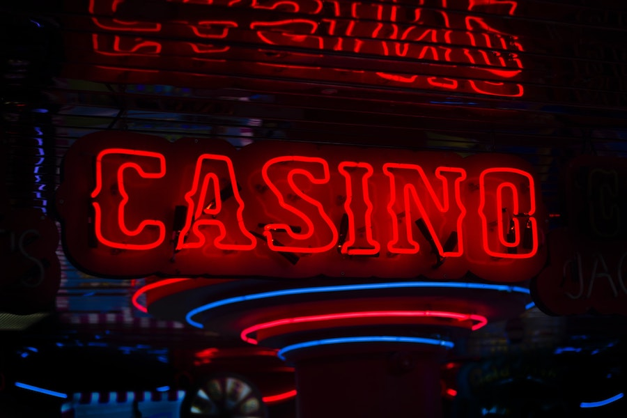 neon red casino sign with dark background