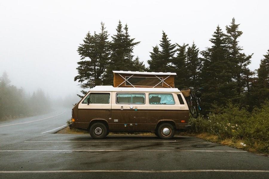 Camper van stealth camping in parking lot.
