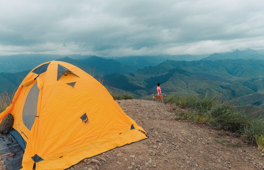 Yellow Tent With Dog on Mountain Top