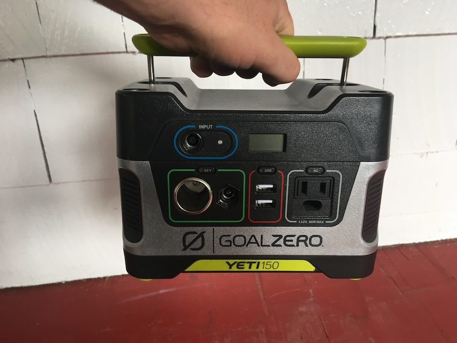 person carrying the Goal Zero Yeti 150 by the built-in carry handle